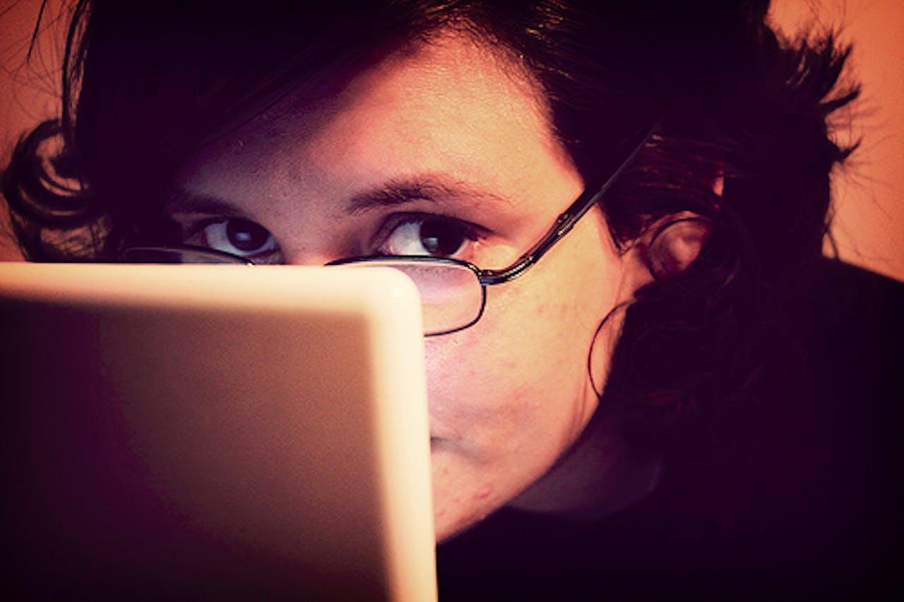 peeking-over-laptop